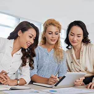 Group of girl doing team work on project