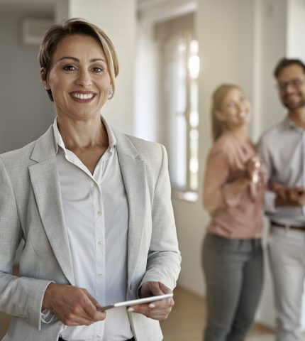 Portrait of happy female real estate agent
