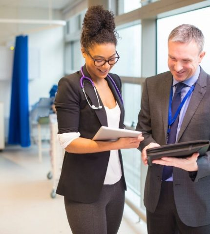 Insurance broker discussing Healthcare plan with physician