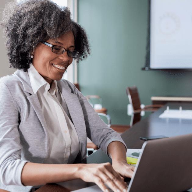 Women typing something on her laptop