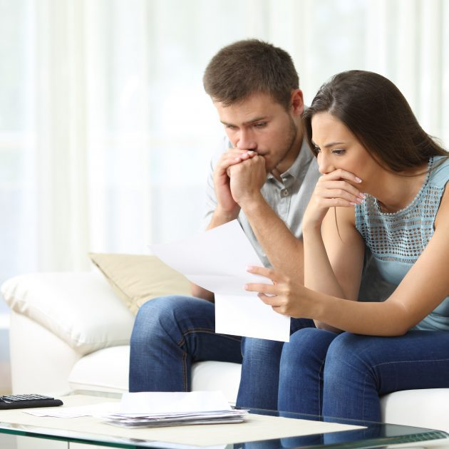 Couple discussing about buying an insurance from Trusted Advisor