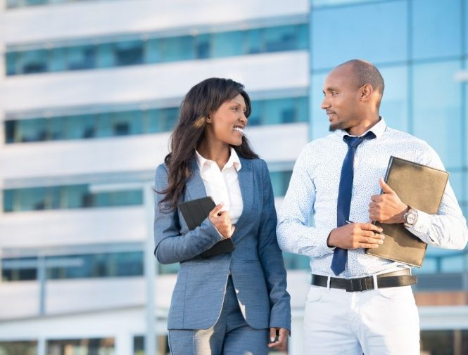 Couple seeing in each other eyes while discussing about broker employee benefits