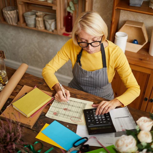 Girl doing an accounting before purchasing insurance of her business