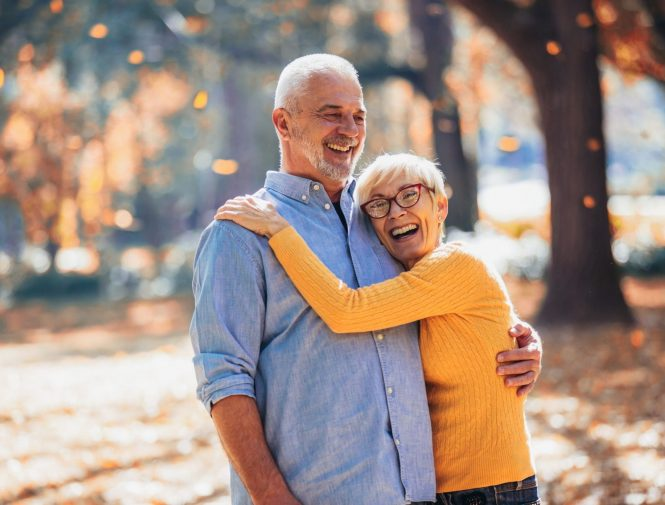 Senior citizen couple looks happy with Medicare Plan