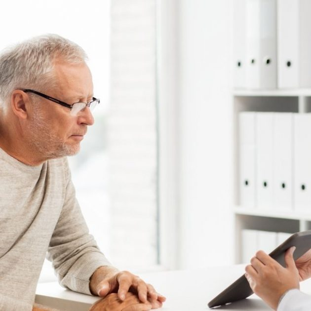 Insurance Agent explains about insurance Medicare plans to the senior person