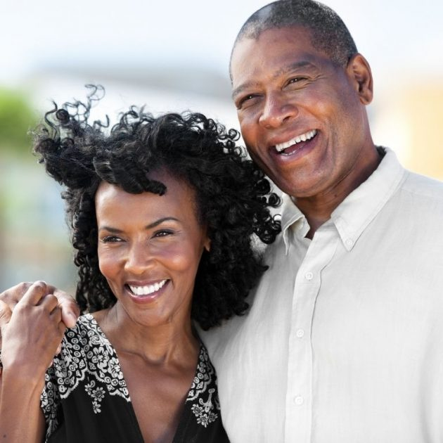 High Net Worth Couple looks happy with their insurance plan