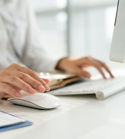 Women typing something on her computer