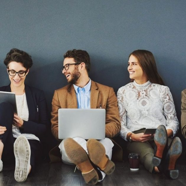 Group of people reading our insurance blog and article and stay connected with each other