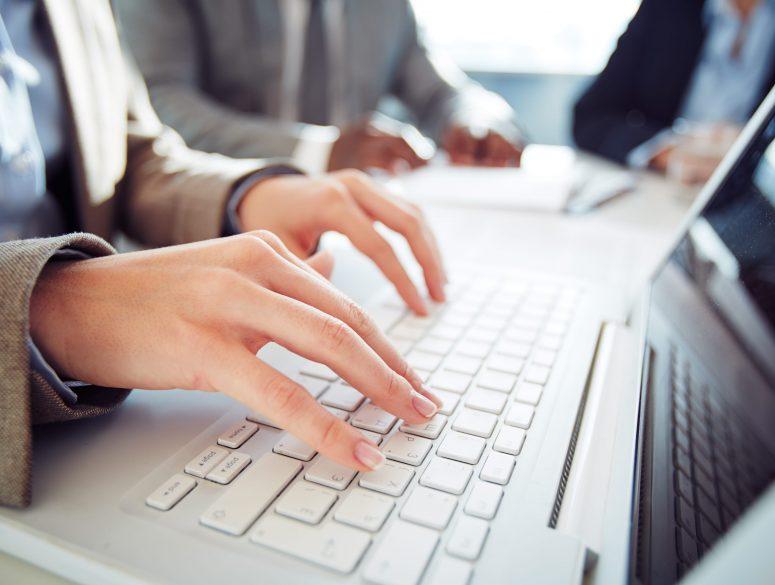 Girl typing something on her laptop