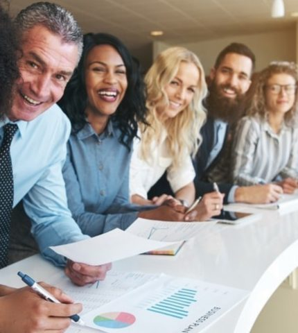 Group of insurance broker looks happy in the office