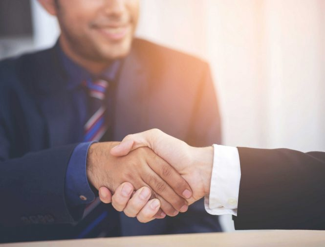 Two men shaking hand on closing the business deal