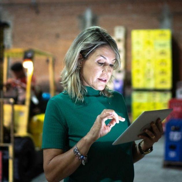 Women learning on FreemdomU app from her iPad