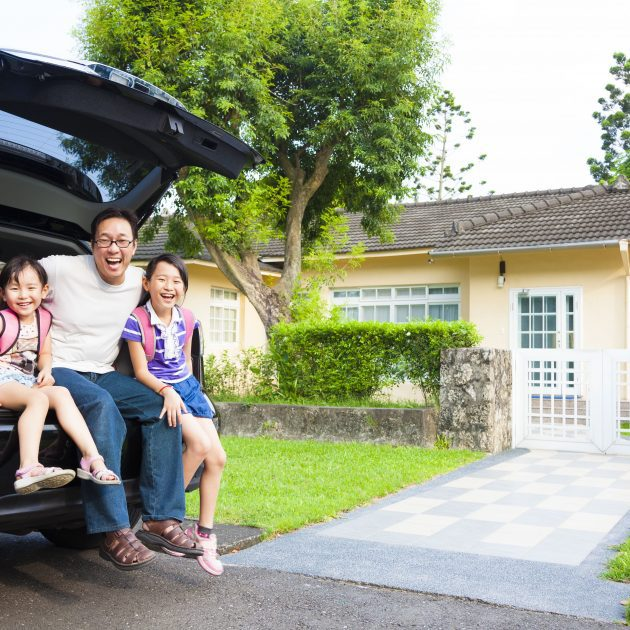 Dad and his two daughters looks happy with Home & Auto Insurance