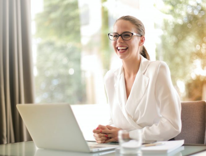 Young women looks happy while working on her office