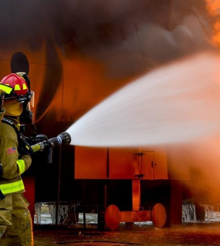 firefighter helps to reduce fire