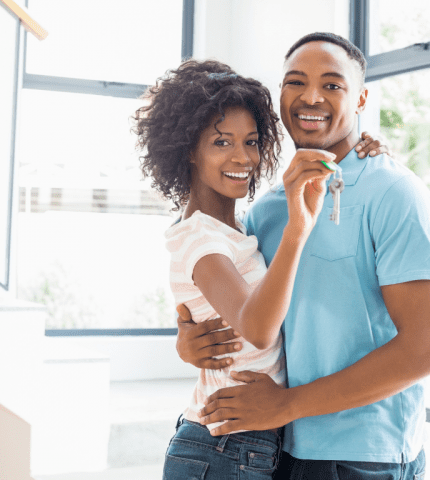 Couple looks happy with an purchase of homeowners insurance