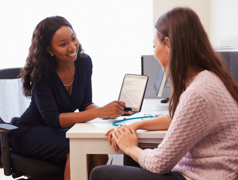 Two women discussing about buyer's homeowners insurance