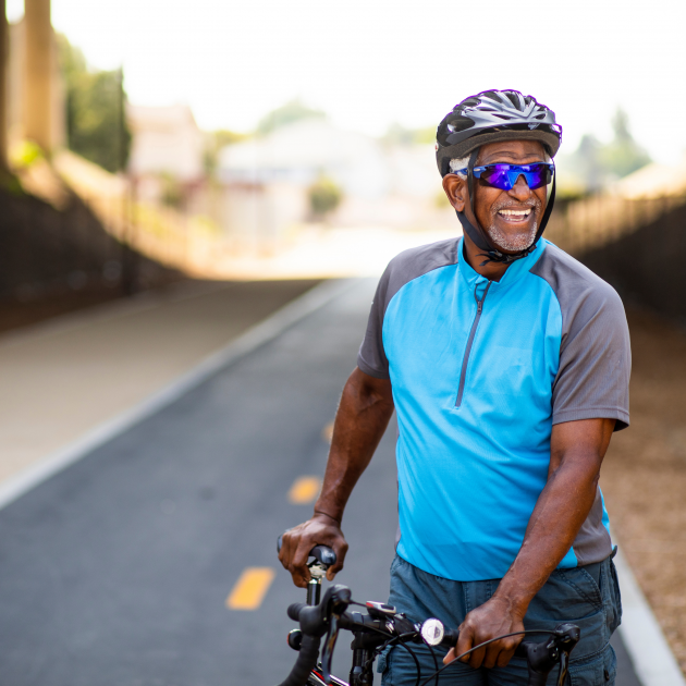 Men with happy smile riding a bicycle