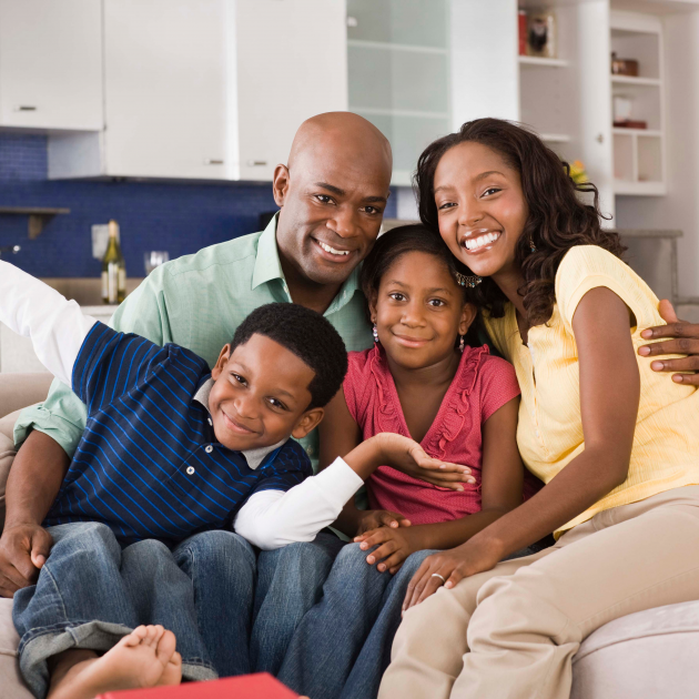 Asian Family looks happy and seated on the sofa