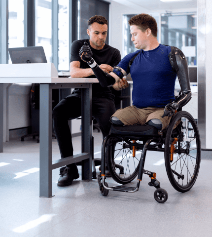 Insurance broker discuss healthcare insurance plan with a handicapped person